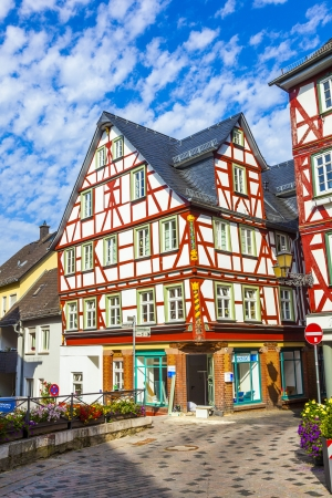 WETZLAR, GERMANY - AUG 26: old half timbered houses  with carvings on AUG 26,2011 in Wetzlar, Germany. Wetzlar was temporary home to the famous writer Goethe back in 1772. Stock Photo - 18144822