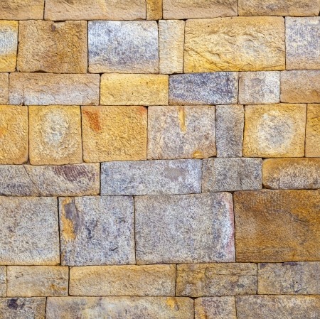 quitab: stone wall at Qutub Minar, Delhi India  Stock Photo