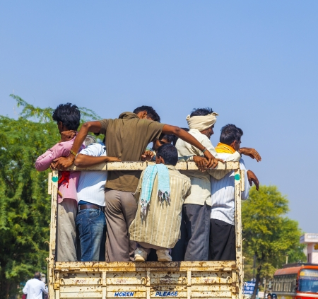 DAOLA, INDIA - 25 OCT: people on highway 71 in overloaded truck on OCT 24, 2012 in Daoloa, India. Overload ist the most dangerous reason for car accidents.