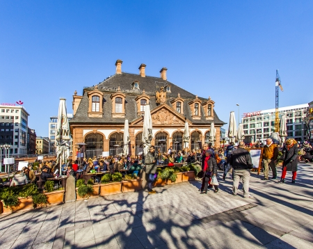 paveway: FRANKFURT, GERMANY- March 2: people enjoy the first sunny day of the year on March 2,2013 in Frankfurt, Germany. The baroque building Hauptwache was built in 1730 and gave the place its name.