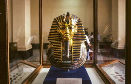 realism: CAIRO, EGYPT - JUNE 10: The Gold Mask of Tutankhamun, composed of 11 kg of solid gold, is on display at the Egyptian Museum on June, 10,1992 in Cairo,Egypt.