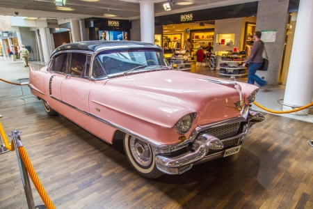 graceland: FRANKFURT, GERMANY - JUNE 8:  pink 1956 Cadillac at the airport on June 8, 2012 in Frankfurt, Germany. It belongs to the museum of Sinsheim with more than 1 Millon visitors per year.