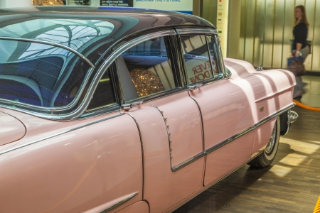 numberplate: FRANKFURT, GERMANY - JUNE 8:  pink 1956 Cadillac at the airport on June 8, 2012 in Frankfurt, Germany. It belongs to the museum of Sinsheim with more than 1 Millon visitors per year.