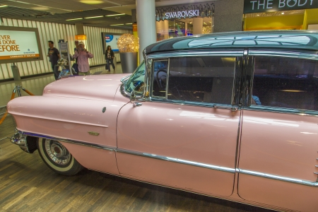 brougham: FRANKFURT, GERMANY - JUNE 8:  pink 1956 Cadillac at the airport on June 8, 2012 in Frankfurt, Germany. It belongs to the museum of Sinsheim with more than 1 Millon visitors per year.