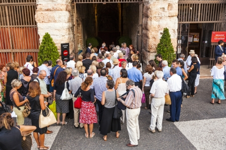 1st century ad: VERONA, ITALY  - AUG 4: visitors wait outside the arena di verona for entrance in the opera on  Aug 4,2009 in Verona, Italy.  The Arena was built by the Romans in the 1st century AD, in the Augustan period. Editorial
