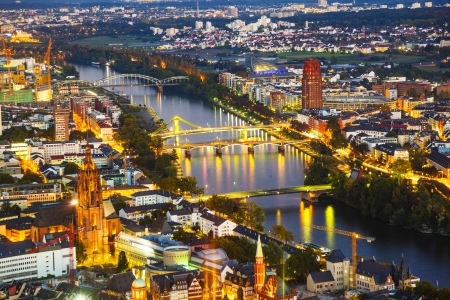 aerial of frankfurt by night with river Main photo