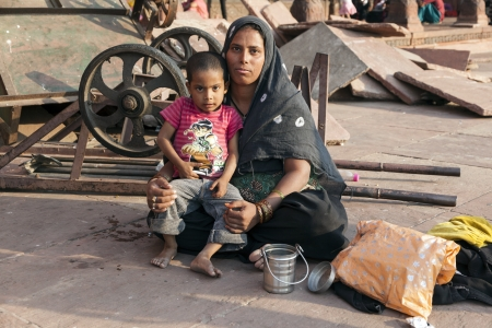 jama mashid: DELHI, INDIA - NOV 8: mother with child rests on the courtyard of Jama Masjid Mosque in Delhi on Nov 8,2011. Jama Masjid is the principal mosque of Old Delhi in India.