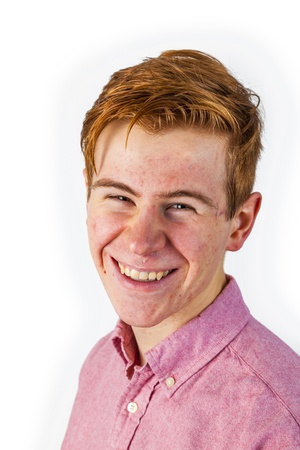 puberty: portrait of attractive laughing smiling boy in puberty isolated on white