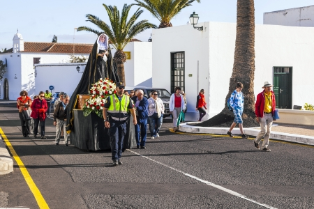 Centrepiece: YAIZA, SPAIN - MARCH 30: easter procession with holy Mary on March 30, 2013 in Yaiza, Spain. The centrepiece of every procession is the Virgin Mary, exquisitely decorated.