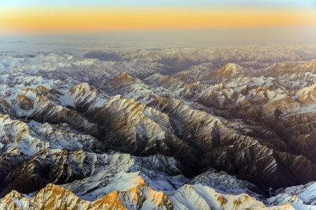 beautiful view from the aircraft to the mountains in Tashkent, china and Kirgistan, covered with snow photo