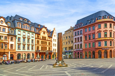 introspective: MAINZ, GERMANY - APRIL 14: beautiful market place on April 14, 2013 in Mainz, Germany. In the middle is the famous 1000 years old HHeunensaeule made of sandstone. Editorial