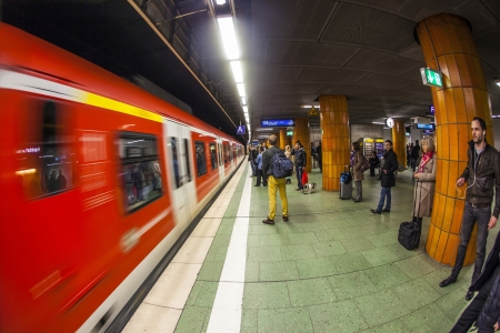 8 12: FRANKFURT, GERMANY - APR 12: people wait at the metro station for the arriving train on Apr 12,2013 in Frankfurt, Germany. The Metro station was inaugurated 1978 after 8 years under construction. Editorial