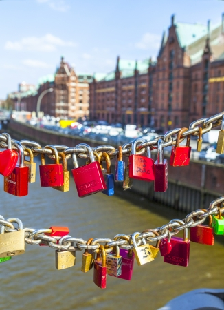 HAMBURG, GERMANY - APRIL 18: lockers at the Speicherstadt bridge symbolize love for ever on April 18,2013 in Hamburg, Germany. More than 1000 lockers of loving couples are on that heavily used pedestrian bridge.