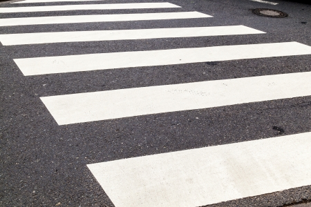pedestrian crossing marked with white paint photo