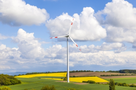 wind turbine generating electricity on blue sky photo