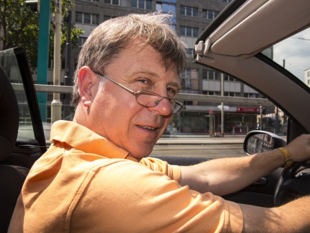 man driving his cabrio at a sunny day photo