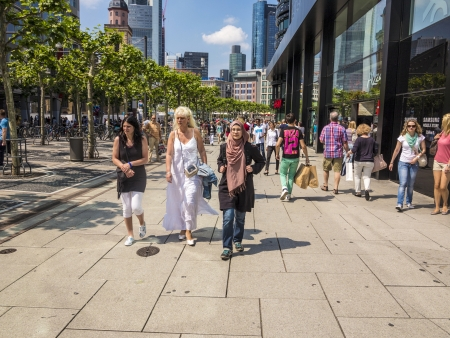 paveway: FRANKFURT, GERMANY - JUNE 8: people walk along the Zeil in Midday on June 8,2013 in Frankfurt, Germany. Since the 19th century it is of the most famous and busiest shopping streets in Germany.