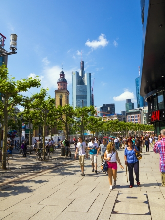 walking zone: FRANKFURT, GERMANY - JUNE 8: people walk along the Zeil in Midday on June 8,2013 in Frankfurt, Germany. Since the 19th century it is of the most famous and busiest shopping streets in Germany.