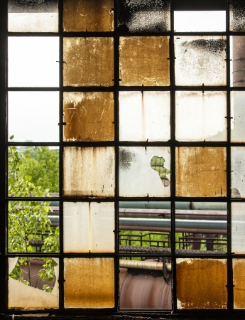 pattern of old broken industry window gives a harmonic background photo