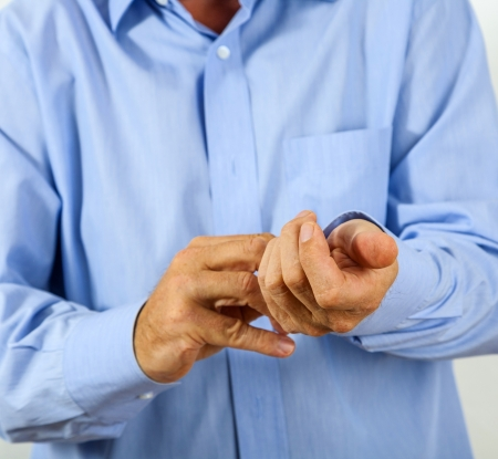buttoning: man buttoning his shirt
