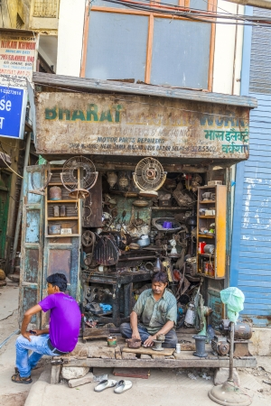 jama mashid: NEW DELHI, INDIA - OCT 10:  owner of a car sparepart shop waits for customer in the shade at the weekly big Urdu market near Jama Mashid on October 10, 2012 in New Delhi, India.