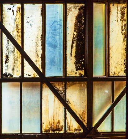 dirty window of old iron works plant Stock Photo - 20557808