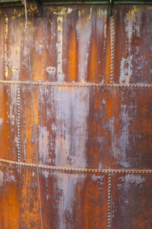 pattern of rusty metal of an old chimney photo