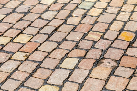 Abstract background of cobblestone pavement photo