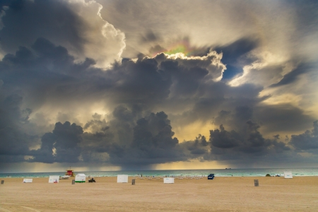 light refractions in the dark clouds at south beach in Miami