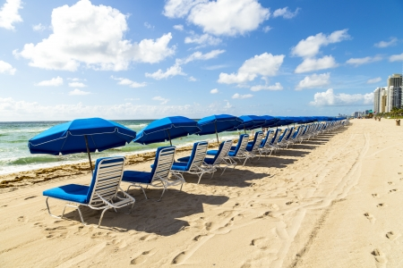umbrellas and empty beach couches at the beach in Miami Stock Photo - 21331515