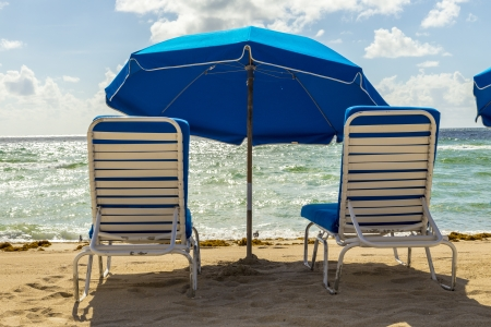 umbrellas and empty beach couches at the beach in Miami Stock Photo - 21331517