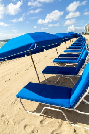 umbrellas and empty beach couches at the beach in Miami Stock Photo - 21331519