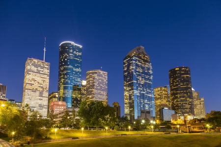 View on downtown Houston by night with skyscraper 写真素材