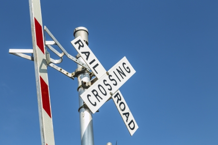 Railroad warning crossing sign under clear blue sky Stock Photo - 21378700