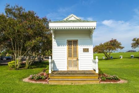 lift lock: historic Plaquemine doctors house at the Plaquemine lock under blue sky
