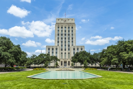 town halls: Houston City Hall with Fountain and Flag Stock Photo