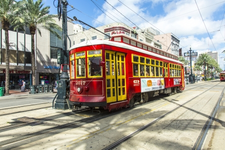 streetcar: red trolley streetcar on rail in New Orleans French Quarter Editorial