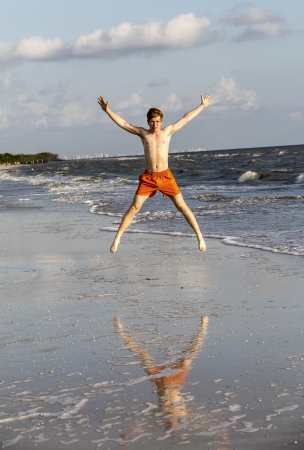 teenager enjoys jogging along the beautiful beach photo