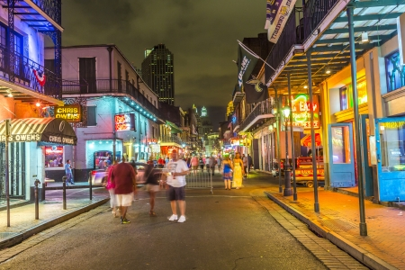 NEW ORLEANS, LOUISIANA - JULY 14: Neon lights in the French Quarter on July 14, 2013. Tourism provides a much needed source of revenue after the 2005 devastation of Hurricane Katrina.