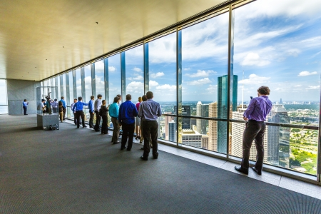 HOUSTON, USA - JULY 11  people enjoy the scenic view from JPMorgan Chase tower on July 11, 2013 in Houston, USA  The visitor platform is open to public during office hours without entrance fee