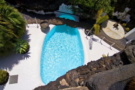 manrique: TAHICHE, SPAIN - AUG 8  Swimming pool in natural volcanic rock area, designed from Cesar Manrique the most importand artist of Lanzarote on Aug 8, 2007 in Tahiche, Spain  Editorial