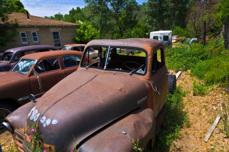 rusty car: GLENDALE, USA - JULY 17  junk yard with old rotten rusty classic cars on July 17, 2008 in Glendale, USA  the price of the wrecks is written on the window shield  Editorial