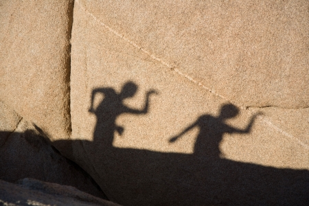 shadow game of children with Scenic rocks  in Joshua tree national park photo