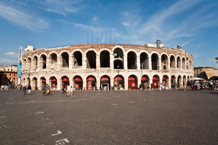verona: VERONA, ITALY - AUG 5: Arena in verona on August 7,2009 in Verona, Italy. People wait for the entrance for the Verdi opera in the old roman Amphi theater from 2d century.