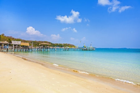 beautiful tropical beach with old wooden pier and huts photo