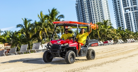 thumps up: MIAMI BEACH, USA - JULY 28: lifeguards return at 6pm on July 28, 2013 in Miami Beach, USA. Beach patrol became existing in 1926. Since that time the  Ocean Rescue division guards the beach in Miami.