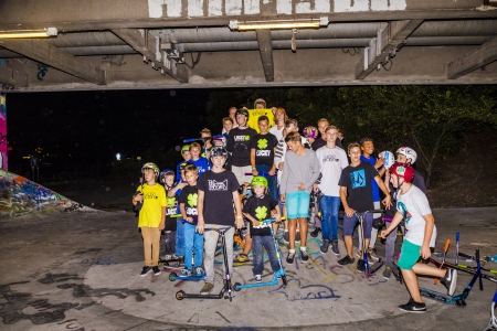 HEIDELBERG, GERMANY - AUG 26  world scooter champ Dakota Schuetz shows some of his tricks and teaches children on August 26, 2013 in Heidelberg, Germany at a public location called bridge park