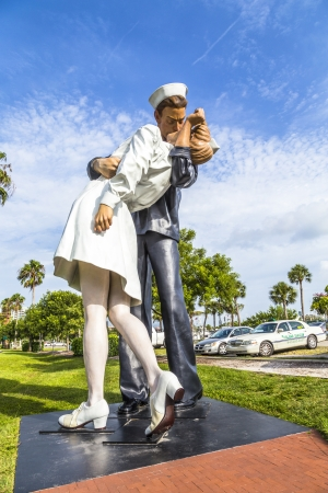 end times: SARASOTA, USA - JULY 25: statue Unconditional surrender by Seward Johnson from 2006 show a sailor and a nurse kissing at times square after proclamation of WW2 End on July 25, 2013 in Sarasota, USA. Editorial
