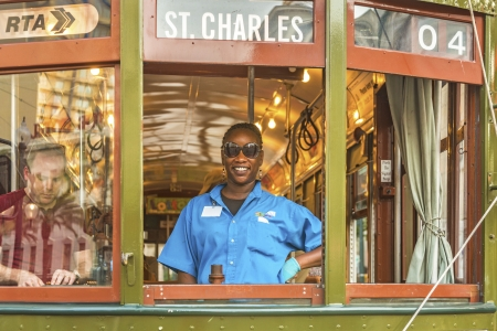 NEW ORLEANS - JULY 17  friendly conductor in the  famous old Street car St  Charles line on July 17, 2013 in New Orleans, USA   It is the oldest continually operating street car line in the world  新聞圖片