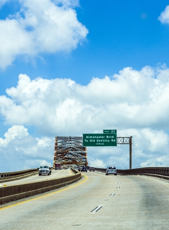 orleans parish: NEW ORLEANS - JULY 17  green bridge on July 17, 2013 in New Orleans, USA  The Green Bridge carries Louisiana Highway 47 across the Mississippi River Gulf Outlet between St  Bernard Parish and New Orleans  The bridge earned its name because it was original Editorial